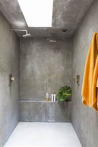 the bathroom walls are finished in concrete photo laure
