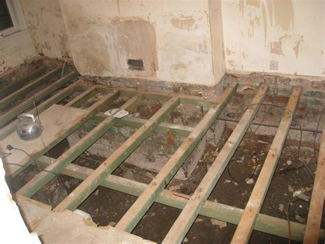 Strengthen joists and lay chipboard T&G flooring