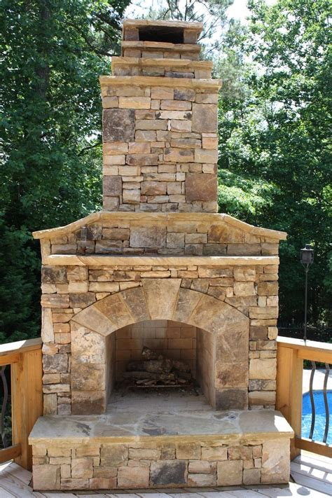 Outdoor Stone Fireplace On Wood Deck  Fireplaces And