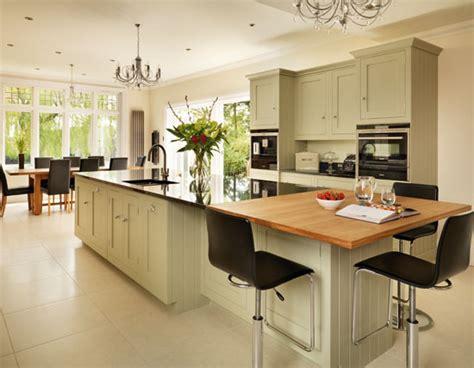 granite kitchen islands with breakfast bar a wooden breakfast bar and granite work surfaces blend 8340