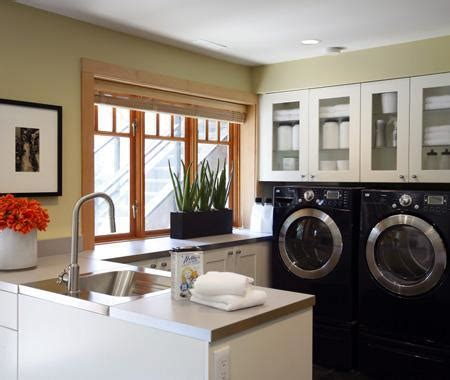 cabinets over washer and dryer countertop above washer dryer transitional laundry