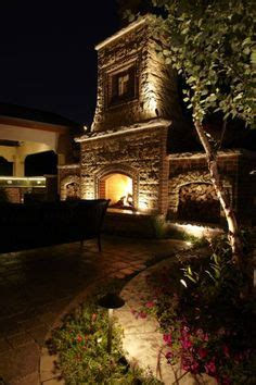outdoor fireplace lighting 1000 images about rock wall lighting effects on pinterest rock wall outdoor fireplaces and