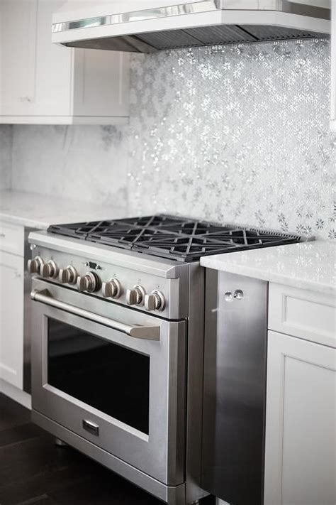 Ivory and White Kitchen with Gray Metallic Tile Backsplash