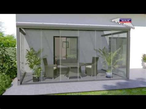 glasschiebewand auf terrasse als windschutz
