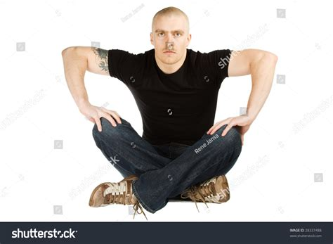 Isolated Man With Angry Face In Black Shirt And Blue Jeans