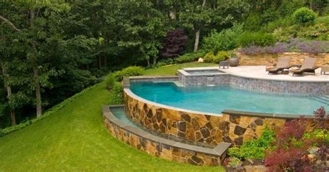arc shaped pool   spa  built   hillside
