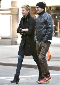 Charlize Theron towers over a male friend on lunch date