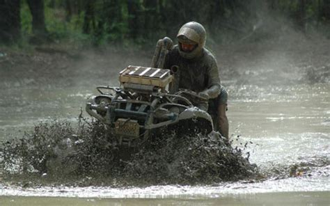 mudding four wheelers mudding four wheelers how to mud wrestle your four wheeler