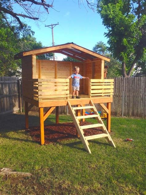 Diy Backyard Forts - he laid out 4 wooden boards in the backyard what he built