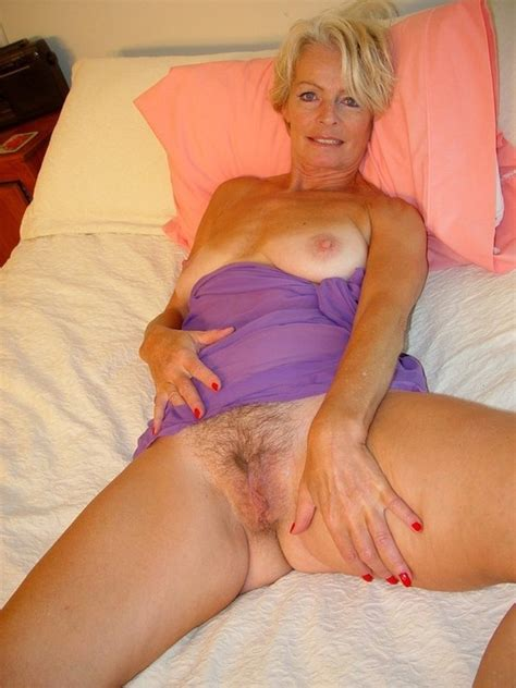 sexy older blonde gran with small tits shows her hairy