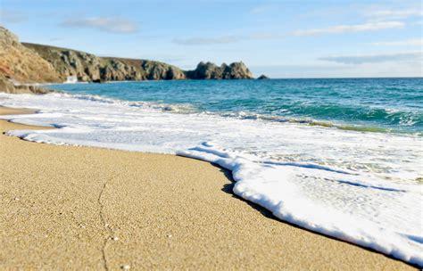 Porthcurno Cove  High Tide  Cornwall Guide