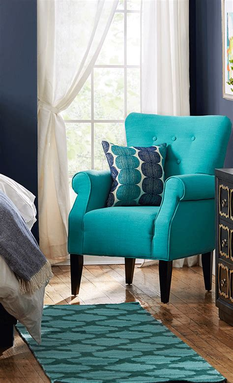 Living Room Chairs by Showcasing Rolled Arms And Tapered Wood Legs This