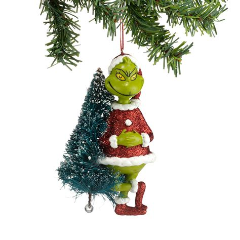 dr seuss the grinch in santa outfit with sisal tree