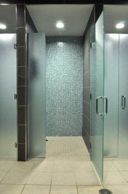 classic fitness center showers  frosted glass doors