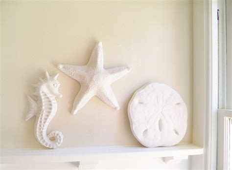 We looked for our absolute favorite sand dollar art that we would have wanted in our own home. Sand dollar wall hanging sculpture, sea shell beach decor, nautical art
