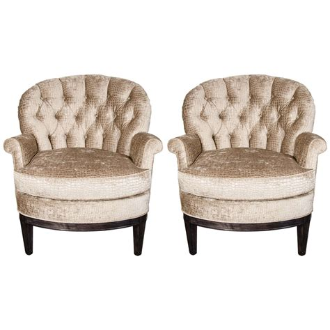 pair of mid century tufted club chairs in crocodile