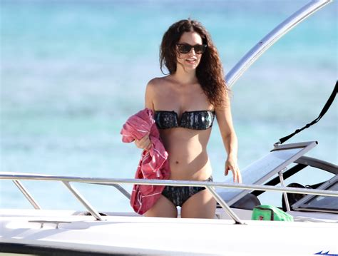 Rachel Bilson pregnant wearing a strapless bikini on a beach in Barbados