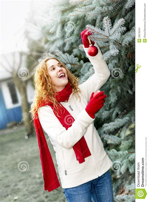 woman decorating christmas tree  stock photo