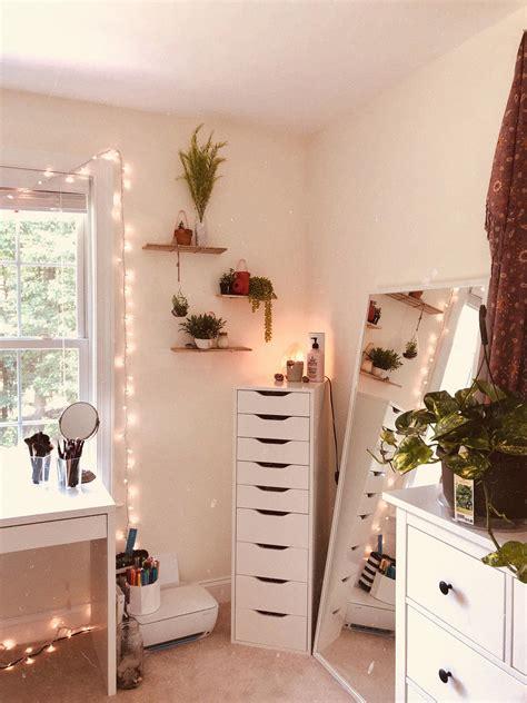 instaatavemoser white walls fairy lights green plants