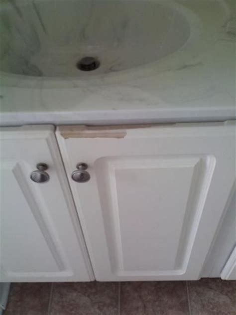 How to fix peeling white cabinets