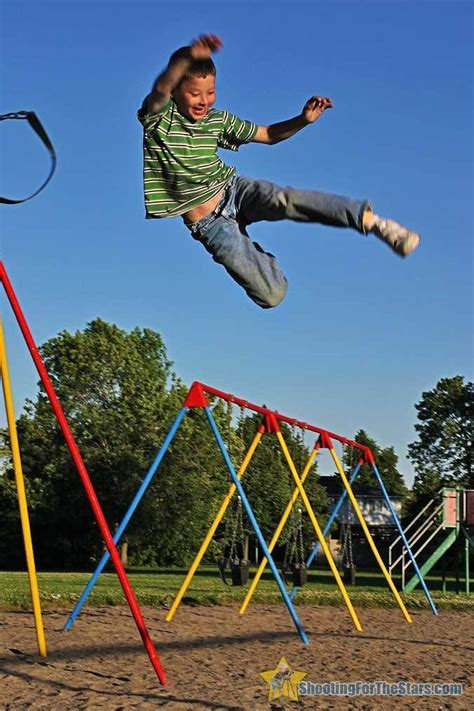 jump swing boy jumping from swing at playground