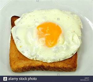 Fried egg on a slice of toast on a white background Stock ...