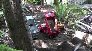 Autocar and Hayes dump trucks dumping gravel - YouTube