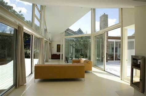 Glass Wall White Living Room  Interior Design Ideas. Room Air Conditioner And Heater. Decorative Globe. Decoration For Bathroom. Where Do Interior Decorators Shop. Table Accessories And Decorations. Decor For Small Living Room. Thanksgiving Front Door Decorations. Nyc Hotel Rooms
