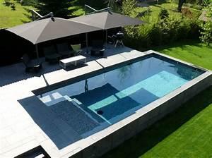 piscine les 3 tendances de cet ete elle decoration With piscine a debordement sur terrain en pente 2 cout construction maison terrain en pente maison moderne