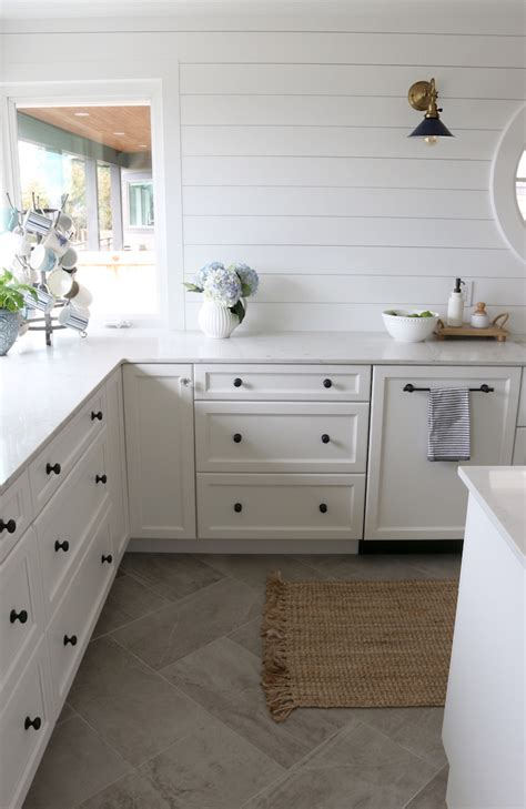kitchen wall and floor tiles adding character with wall sconces the inspired room 8693