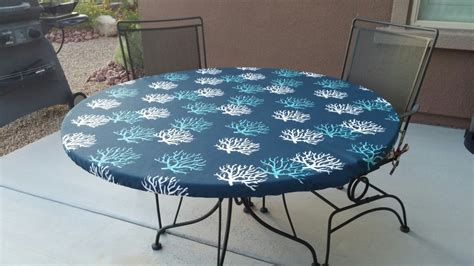 fitted tablecloth in navy teal and white outdoor fabric