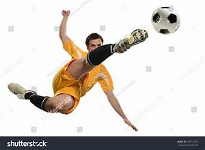 Soccer Player Kicking Ball While Jumping Stock Photo ...