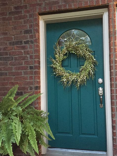 decorated for summer teal painted front door with
