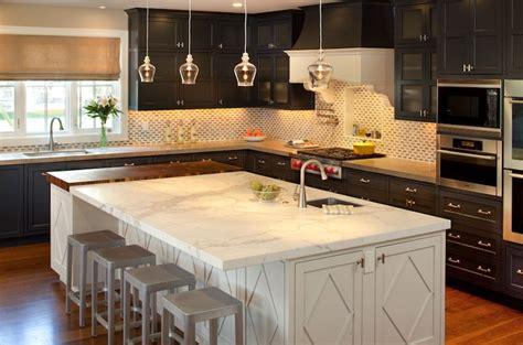 black perimeter cabinets and white kitchen island