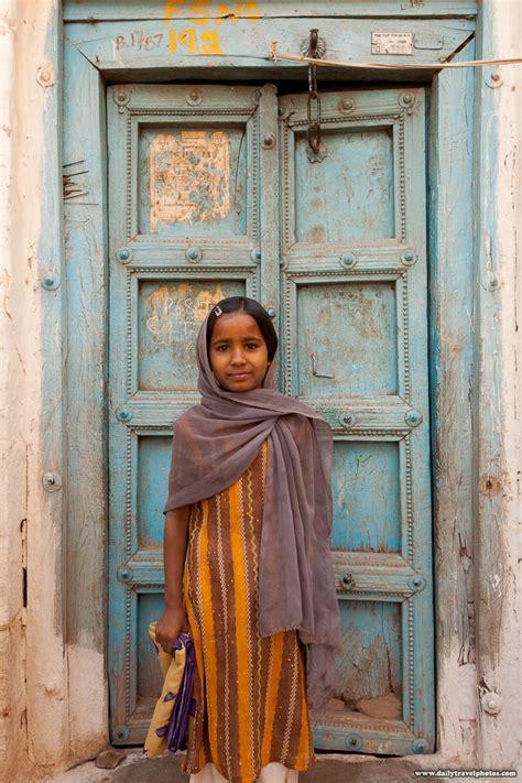door girl  cute indian girl stands  front   worn