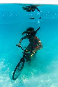 Lance Lung-strong  Activist Model Rides Bike Underwater For Climate Change