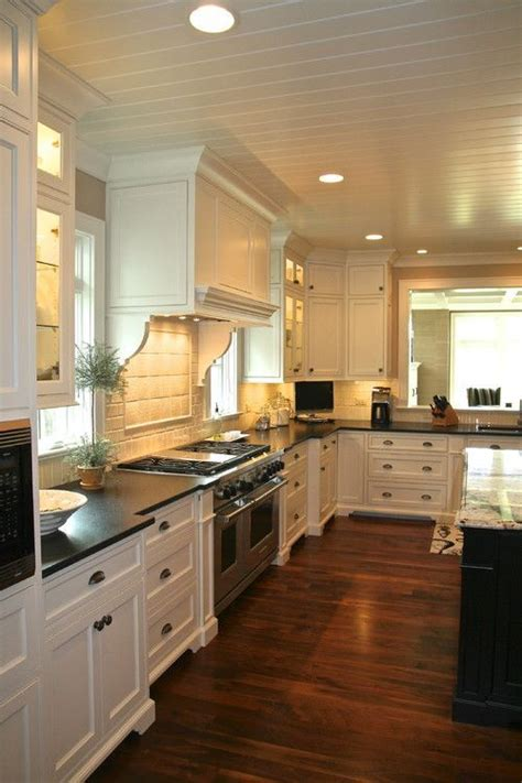 white and dark wood kitchen 30 spectacular white kitchens with dark wood floors 656 | 67b184b38a47bf943510d768969f4bdb