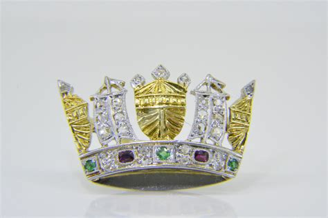 Naval crown brooch with diamonds emeralds and rubies ...