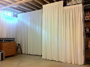 HouseOnaShoestring Hang Curtains In Unfinished Basement
