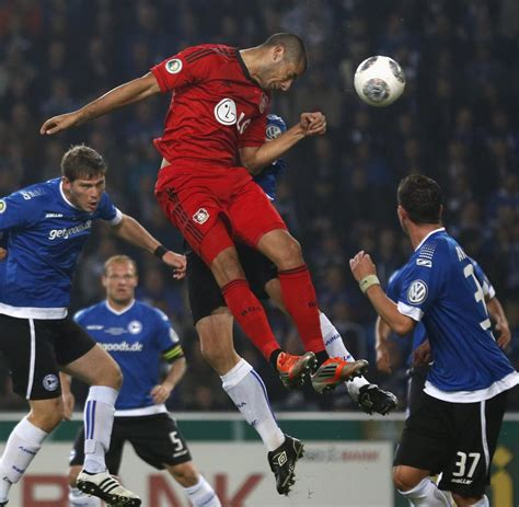 german fussball bundesliga wallpaper topspiel in der eren derdiyok der fl 252 chtling trifft seinen hoffenheimer 460 | Bayer Leverkusen s Derdiyok and Arminia Bielefeld s Klos jump for a ball during the second round of their German soccer cup DFB Pokal match in Bielefeld