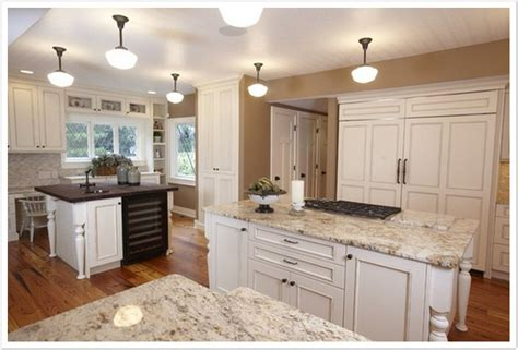 granite countertops with white cabinets manicinthecity