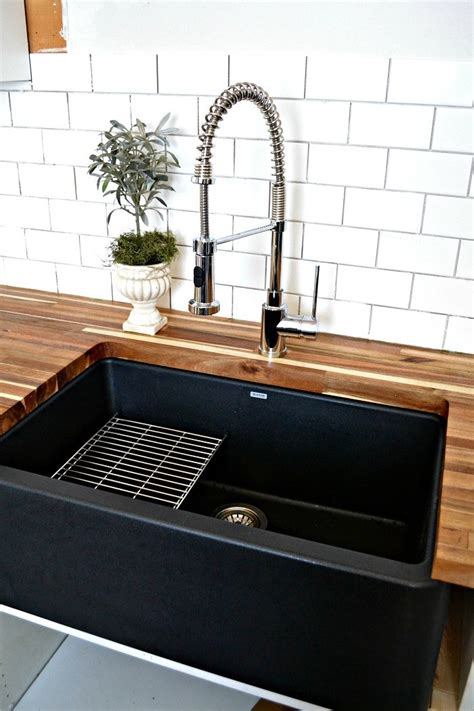 fragranite kitchen sinks a black farmhouse sink gives our country kitchen a warm feel 1051