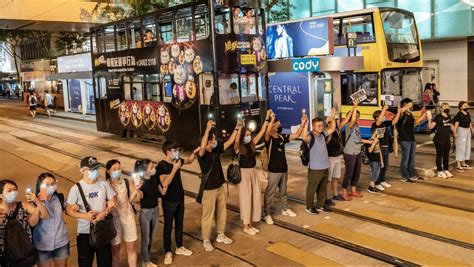 hong kong  pictures protesters human chain  city quartz