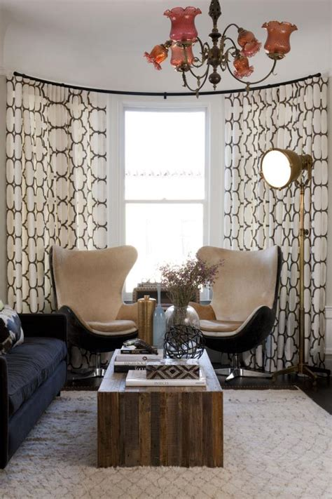 eclectic living room  mid century modern egg chairs hgtv