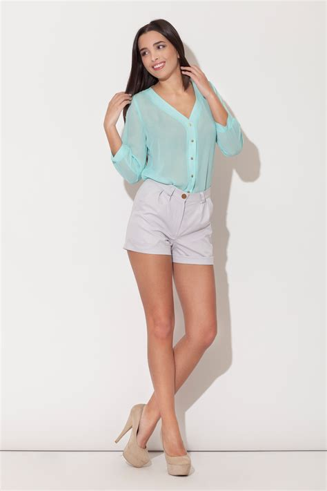 plunging neckline blouse green plunging v neckline blouse with metallic buttons