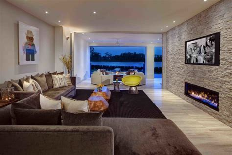 stacked stone fireplaces   warm  modern