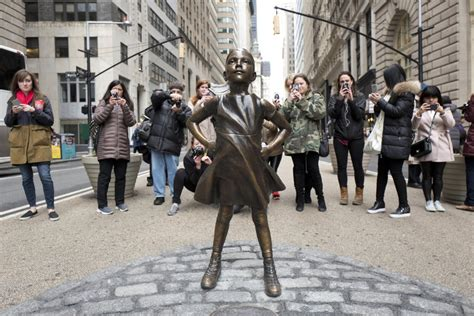 fearless girl statue stares  wall streets iconic