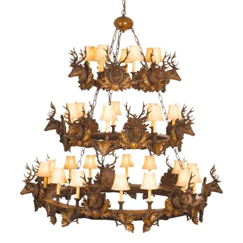 small stag heads three tier chandelier