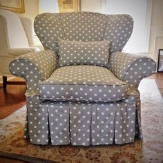 funky shaped chair with custom slipcover in gray white