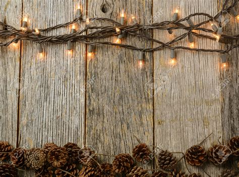 Rustic : Christmas Lights And Pine Cones On Rustic Wood Background